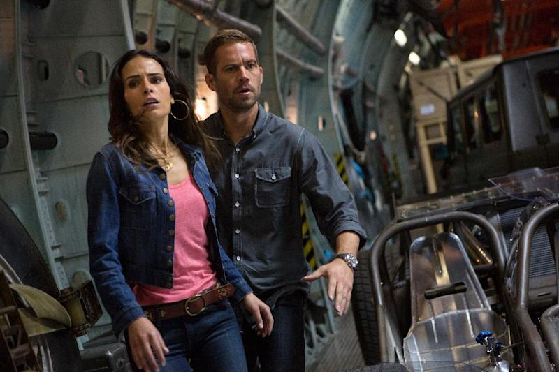 "This film publicity image released by Universal Pictures shows Jordana Brewster, left, and Paul Walker in a scene from ""Fast & Furious 6."" Universal Pictures has delayed the release of ""Fast & Furious 7"" for almost a year following the death of Paul Walker. The studio announced early Monday, Dec. 23, 2013, that the ""Fast & Furious"" sequel will be released in April 2015, instead of July next year. Shooting on the film was about midway through when the 40-year-old Walker died in a car crash outside of Los Angeles. (AP Photo/Universal Pictures, Giles Keyte)"
