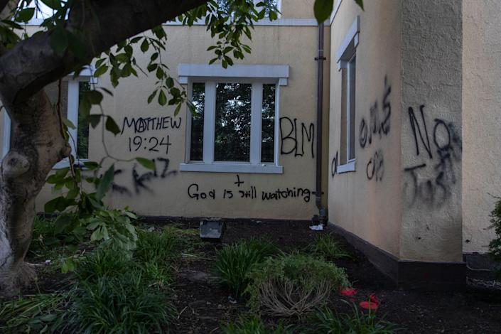 """Graffiti says """"God is still watching"""" on the exterior walls of St. John's Episcopal Church near the White House on June 1, 2020, after a night of protests over the death of George Floyd. (Photo: AP Photo/Carolyn Kaster)"""