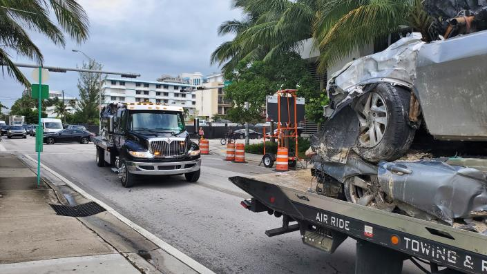 Vehicles that were pulled from the rubble of the Champlain Towers South are transported on Saturday, July 10, 2021 in Surfside, Fla. Surfside Mayor Charles Burkett said crews were making good progress, especially in clearing debris from the section of the building that didn't collapse but was later demolished. That section will likely be cleared sooner than originally expected, he said. (AP Photo/David Fischer)