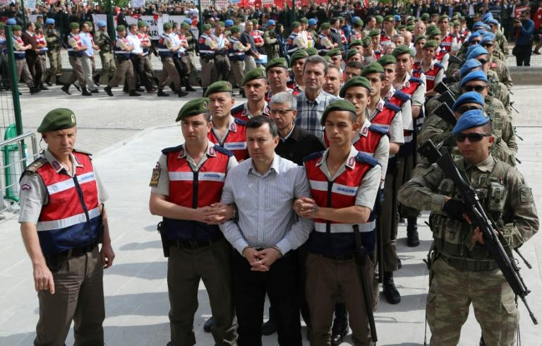 Turkish soldiers accused of being involved in an attempted coup d'etat on 15 July 2016 are led to the court inside the Sincan Prison in Ankara, for their trial, in May 2017