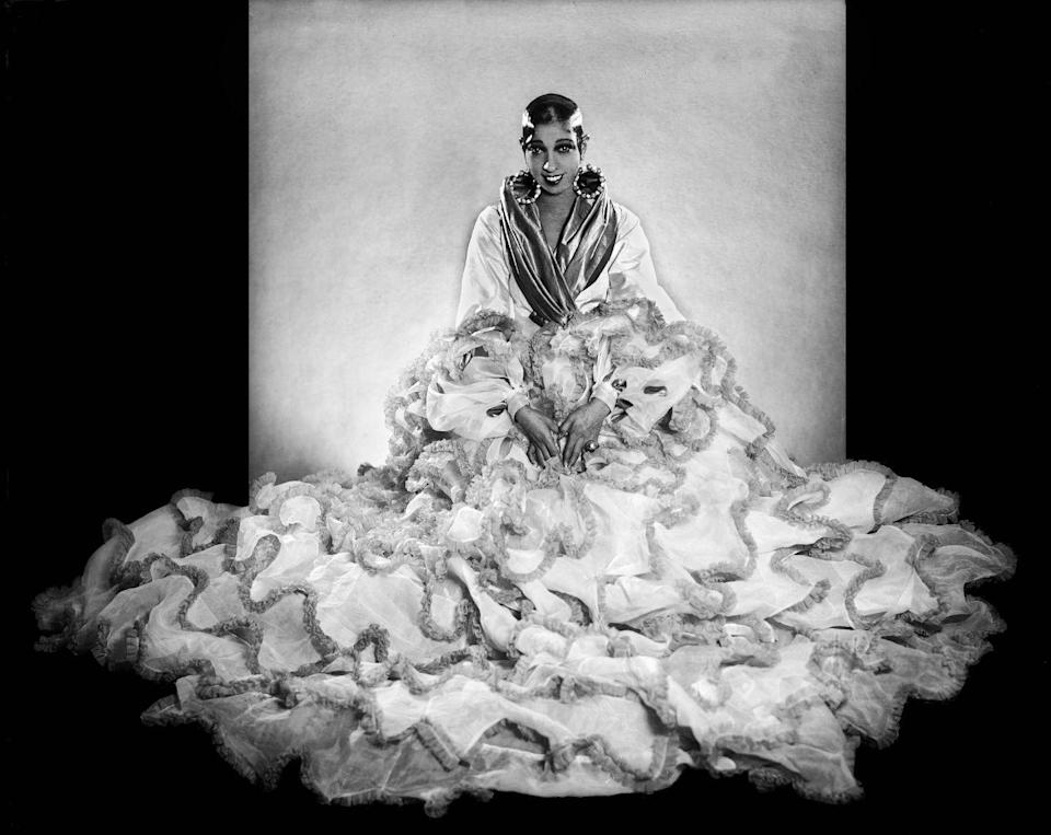 <p>A studio portrait of Baker, which is perhaps one of her most famous, captures the star in all her costume glory, thanks to a magnificent train, sleek bob, and eye-catching jewelry.<br></p>