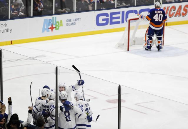 The Toronto Maple Leafs celebrate a goal y John Tavares (91) as New York Islanders goaltender Robin Lehner (40) looks away during the third period of an NHL hockey game Monday, April 1, 2019, in Uniondale, N.Y. The Maple Leafs won 2-1. (AP Photo/Frank Franklin II)