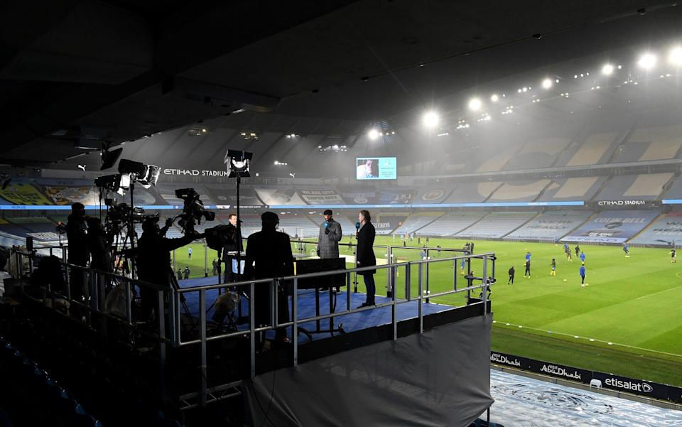 Broadcasters Joleon Lescott and Steve McManaman work for BT Sport prior to the Premier League match between Manchester City and Brighton & Hove Albion - Laurence Griffiths/Getty Images Europe
