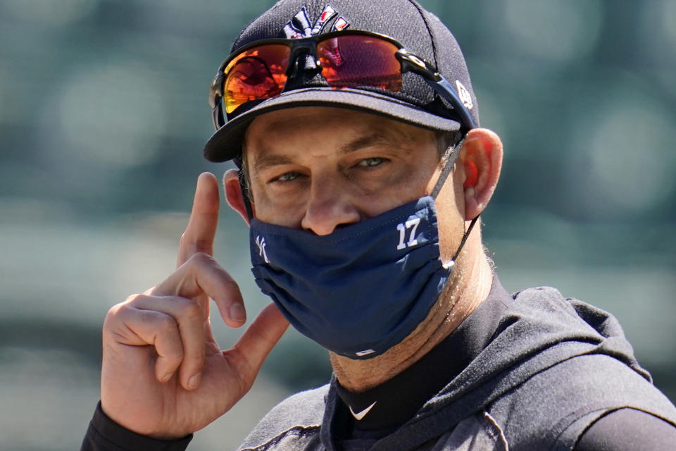 New York Yankees manager Aaron Boone watches batting practice before a spring training exhibition baseball game against the Detroit Tigers at Joker Marchant Stadium in Lakeland, Fla., Tuesday, March 9, 2021. (AP Photo/Gene J. Puskar