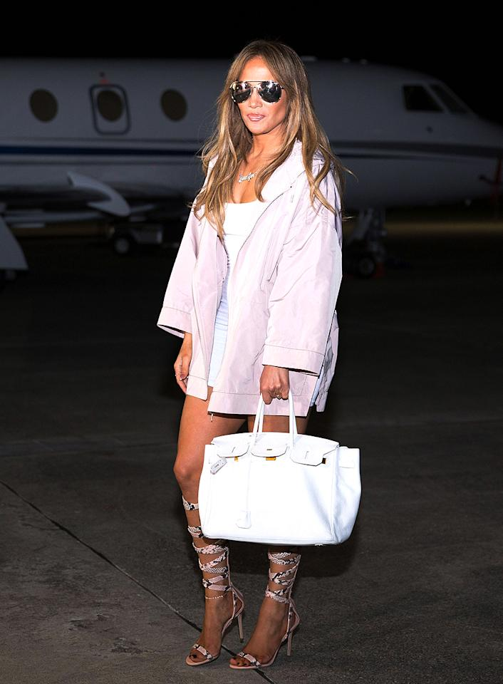 <p>J.Lo arrived for her first concert in the Dominican Republic in style. Although it was dark when her private jet landed, the songstress even sported shades. (Photo: Henry Coradin/Handout/EPA/REX/Shutterstock) </p>
