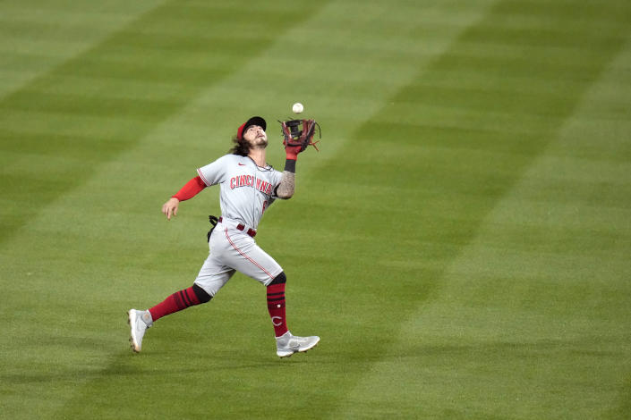 Cincinnati Reds second baseman Jonathan India catches a fly ball by St. Louis Cardinals' Yadier Molina during the sixth inning of a baseball game Friday, June 4, 2021, in St. Louis. (AP Photo/Jeff Roberson)
