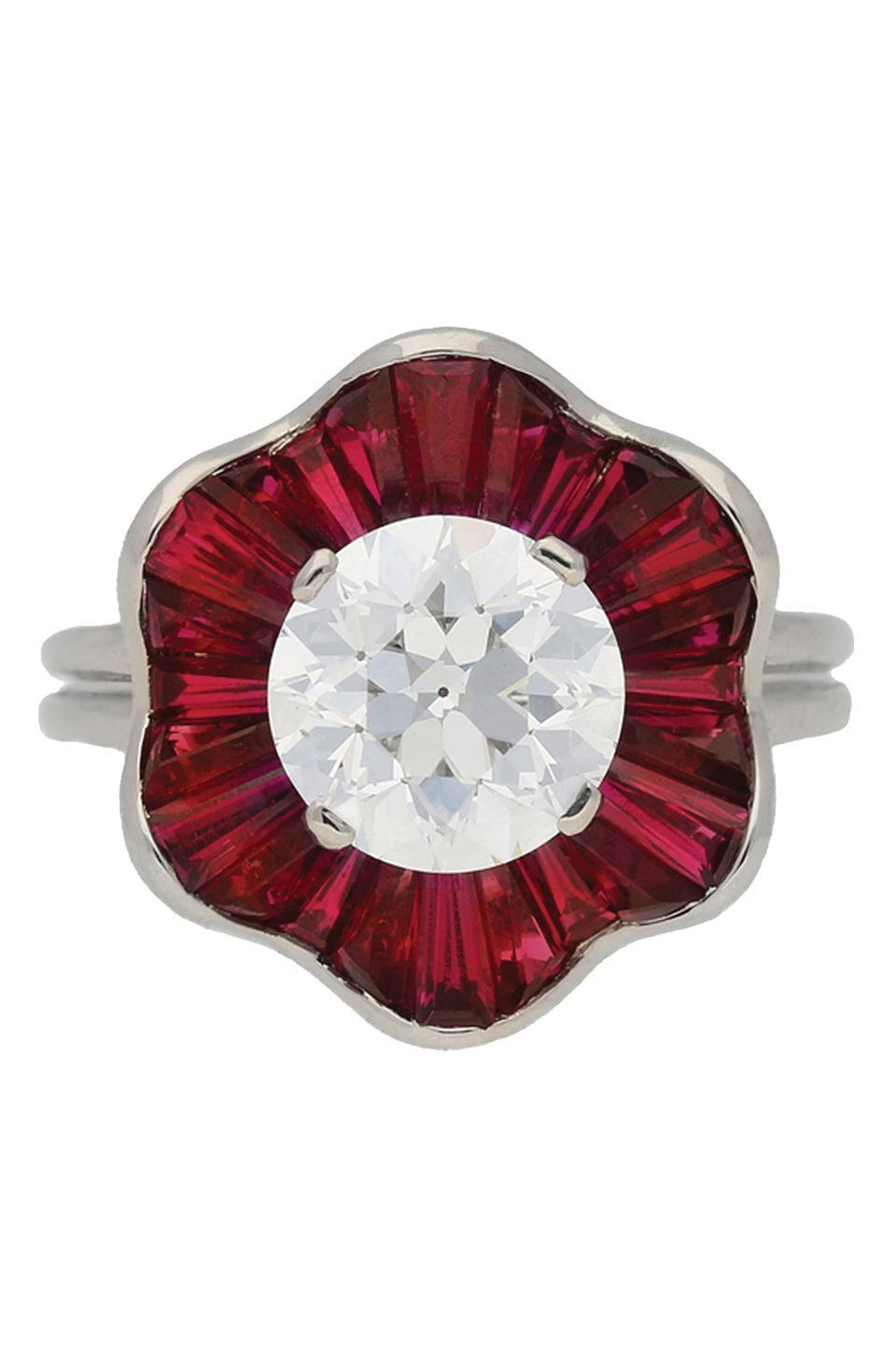 "<p><strong>Oscar Heyman Bro<em>s </em></strong><em>Ruby and Diamond Cluster Ring, circa the 1970s, $68,950.45, <a href=""https://www.1stdibs.com/jewelry/rings/engagement-rings/1970s-oscar-heyman-brothers-ruby-diamond-platinum-cluster-ring/id-j_1347423/"" rel=""nofollow noopener"" target=""_blank"" data-ylk=""slk:1stdibs.com"" class=""link rapid-noclick-resp"">1stdibs.com</a></em></p><p><a class=""link rapid-noclick-resp"" href=""https://go.redirectingat.com?id=74968X1596630&url=https%3A%2F%2Fwww.1stdibs.com%2Fjewelry%2Frings%2Fengagement-rings%2F1970s-oscar-heyman-brothers-ruby-diamond-platinum-cluster-ring%2Fid-j_1347423%2F&sref=https%3A%2F%2Fwww.harpersbazaar.com%2Fwedding%2Fbridal-fashion%2Fg7427%2Fvintage-engagement-rings%2F"" rel=""nofollow noopener"" target=""_blank"" data-ylk=""slk:SHOP"">SHOP</a></p>"