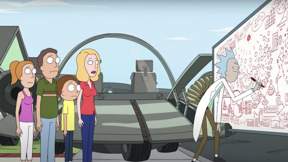 The Smith family stands outside Rick's ship and watches him draw with red marker all over a white board