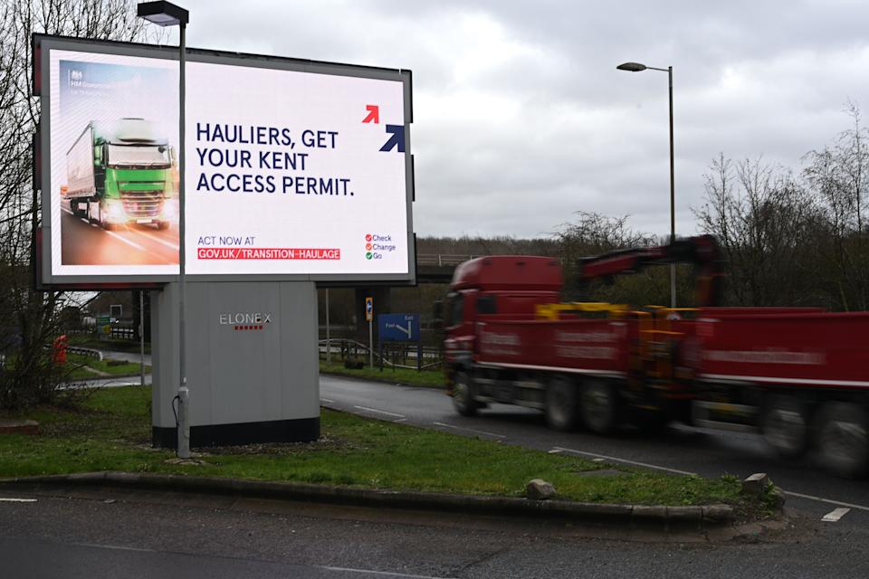 A picture shows an electronic billboard warning hauliers of the new documentation required to travel through Kent for access to the Port of Dover or Eurotunnel since Britain left the EU single market and customs union at a service station off the M25 motorway in Greater London on January 11, 2021. (Photo by DANIEL LEAL-OLIVAS / AFP) (Photo by DANIEL LEAL-OLIVAS/AFP via Getty Images)