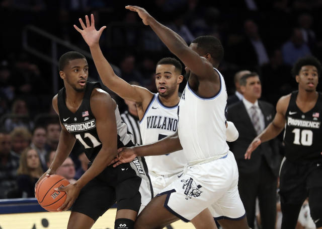 Providence's Alpha Diallo, left, protects the ball from Villanova's Phil Booth and Eric Paschall, right, during the first half of an NCAA college basketball game in the Big East conference tournament, Thursday, March 14, 2019, in New York. (AP Photo/Frank Franklin II)