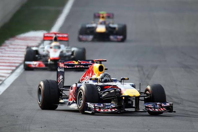 YEONGAM-GUN, SOUTH KOREA - OCTOBER 16: Race winner Sebastian Vettel of Germany and Red Bull Racing leads from second placed Lewis Hamilton of Great Britain and McLaren and third placed Mark Webber of Australia and Red Bull Racing during the Korean Formula One Grand Prix at the Korea International Circuit on October 16, 2011 in Yeongam-gun, South Korea. (Photo by Clive Rose/Getty Images)