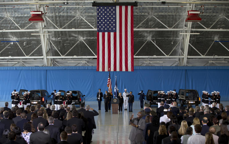 President Barack Obama and Secretary of State Hillary Rodham Clinton attend the Transfer of Remains Ceremony, Friday, Sept. 14, 2012, at Andrews Air Force Base, Md., marking the return to the United States of the remains of the four Americans killed this week in Benghazi, Libya. (AP Photo/Carolyn Kaster)