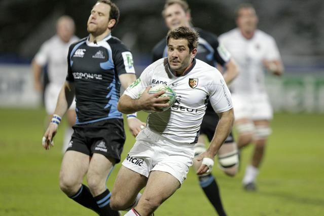 Toulouse's Florian Fritz (C) scores a try against Glasgow Warriors during a Heineken Cup, pool six, rugby union match at Firhill Stadium in Glasgow on December 10, 2010. AFP PHOTO/GRAHAM STUART (Photo credit should read GRAHAM STUART/AFP/Getty Images)