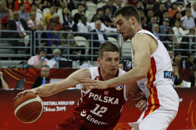 Adam Waczynski of Poland tries to pass through Juancho Hernangomez of Spain during their quarterfinals match for the FIBA Basketball World Cup at the Shanghai Oriental Sports Center in Shanghai, Tuesday, Sept. 10, 2019. (AP Photo/Andy Wong)