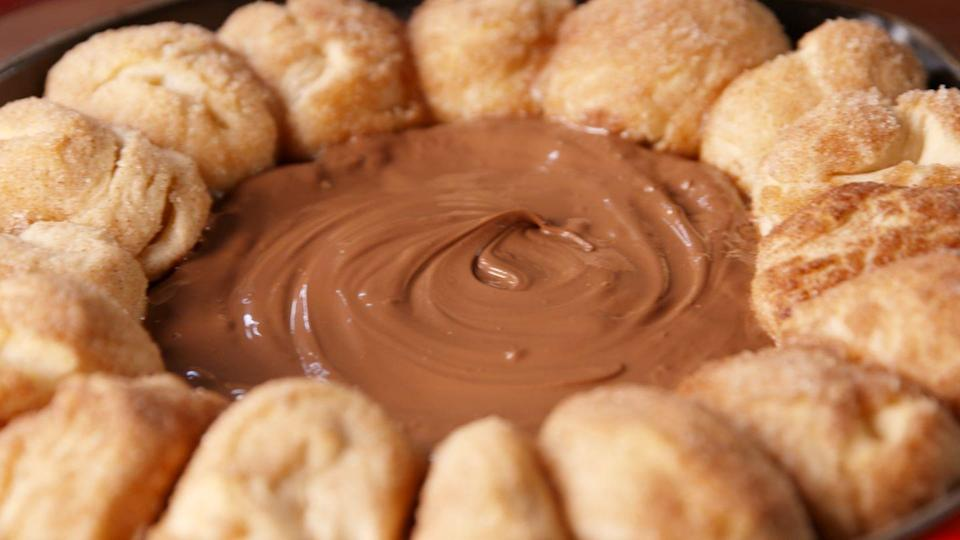 """<p>When churros met Nutella, your world became a better place.<br></p><p>Get the recipe from <a href=""""https://www.countryliving.com/cooking/recipe-ideas/recipes/a49947/chocolate-churro-dip-recipe/"""" rel=""""nofollow noopener"""" target=""""_blank"""" data-ylk=""""slk:Delish"""" class=""""link rapid-noclick-resp"""">Delish</a>.</p>"""