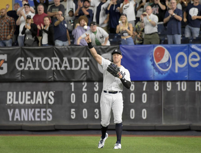New York Yankees right fielder Aaron Judge gets an ovation from the fans as he warms up coming into the baseball game in the eighth inning against the Toronto Blue Jays Friday, Sept. 14, 2018, at Yankee Stadium in New York. (AP Photo/Bill Kostroun)