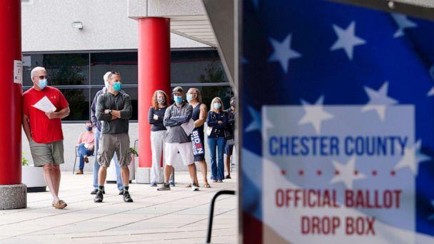 PHOTO: Residents line up to enter Chester County Voter Services in advance of the 2020 General Election in West Chester, Pa., Oct. 23, 2020.  (Matt Slocum/AP)