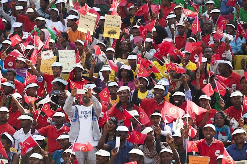 Supporters, some waving the flag of the ruling Ethiopian People's Revolutionary Democratic Front party, attend a rally three days ahead of general elections, on May 21, 2015, in Addis Ababa (AFP Photo/Zacharias Abubeker)