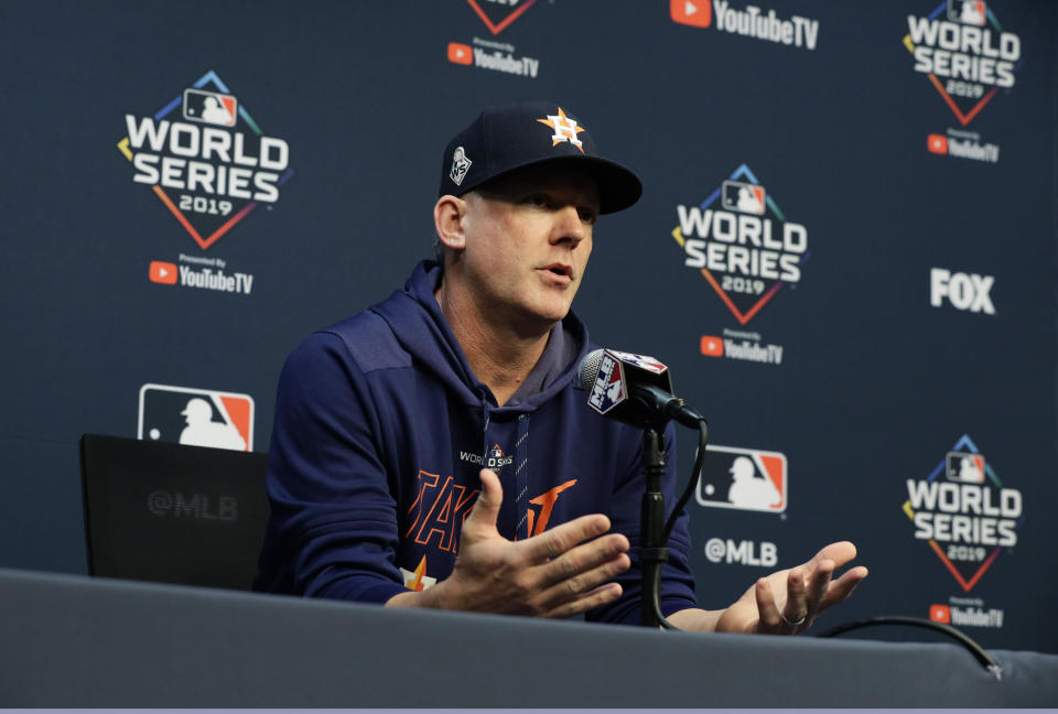 FILE - In this Oct. 28, 2019, file photo, Houston Astros manager AJ Hinch talks to the media during a news conference for baseball's World Series, in Houston. Houston manager AJ Hinch and general manager Jeff Luhnow were suspended for the entire season Monday, Jan. 13, 2020, and the team was fined $5 million for sign-stealing by the team in 2017 and 2018 season. Commissioner Rob Manfred announced the discipline and strongly hinted that current Boston manager Alex Cora the Astros bench coach in 2017 will face punishment later. Manfred said Cora developed the sign-stealing system used by the Astros. (AP Photo/Eric Gay, File)
