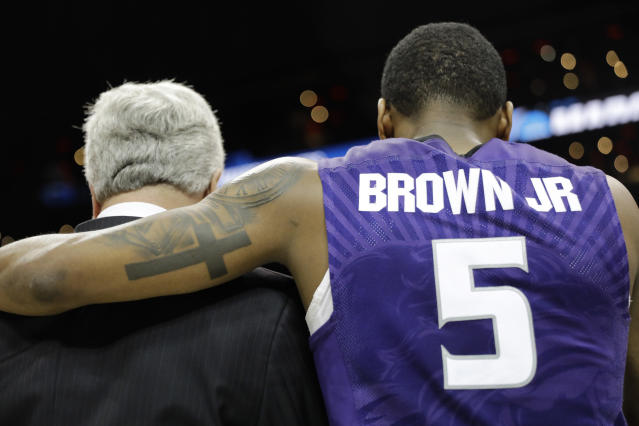 Kansas State guard Barry Brown embraces Kansas State head coach Bruce Weber after a regional semifinal NCAA college basketball tournament game against Kentucky, Friday, March 23, 2018, in Atlanta. Kansas State won 61-58. (AP Photo/David Goldman)