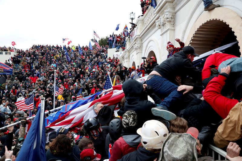 FILE PHOTO: Supporters of U.S. President Donald Trump storm the U.S. Capitol
