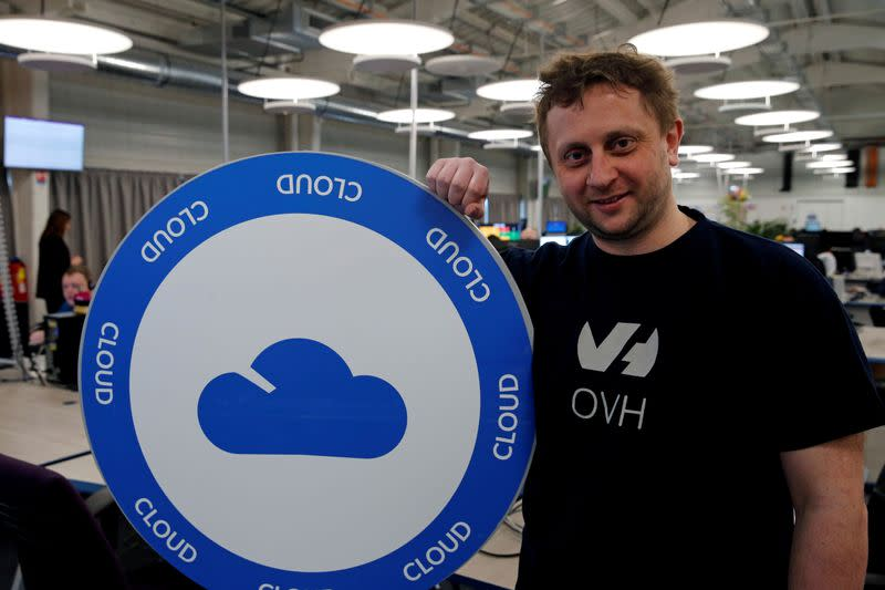 FILE PHOTO: Octave Klaba, founder and CEO of OVH, poses near a company logo at the hotline service desk of French web-hosting and server provider OVH data centre site in Roubaix