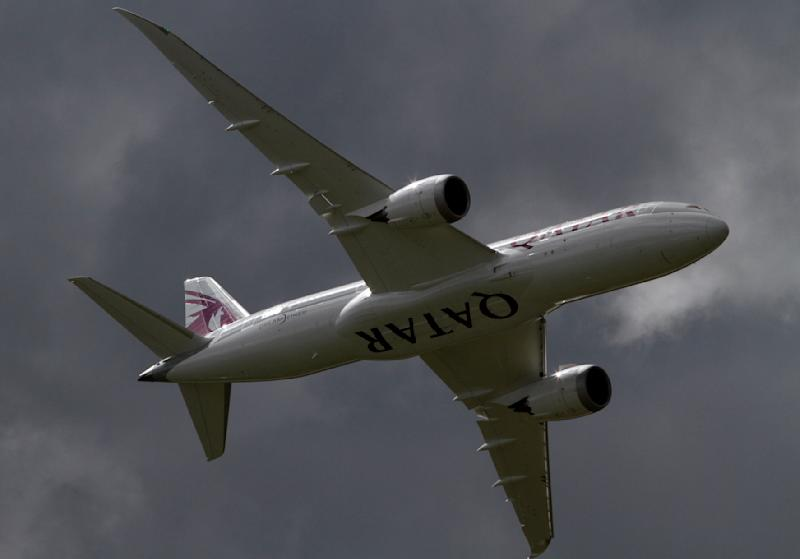 FILE- In this Wednesday, July 11, 2012, file photo, a Qatar Airways Boeing 787 Dreamliner takes off during a display at the Farnborough International Airshow, in Farnborough, England. Boeing Co. posted an unexpected 3 percent improvement in second-quarter net income on strong sales of commercial airplanes. The results surprised Wall Street, and the company raised its earnings forecast for the year. The results announced before the markets opened Wednesday, July 25, 2012, eased investors' fears of an imminent slowdown in the company's defense unit, which produces Chinook helicopters and F-18s, among many other aircraft models.(AP Photo/Lefteris Pitarakis, File)