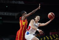 South Korea's Danbi Kim, right, drives to the basket past Spain's Astou Ndour during women's basketball preliminary round game at the 2020 Summer Olympics, Monday, July 26, 2021, in Saitama, Japan. (AP Photo/Charlie Neibergall)