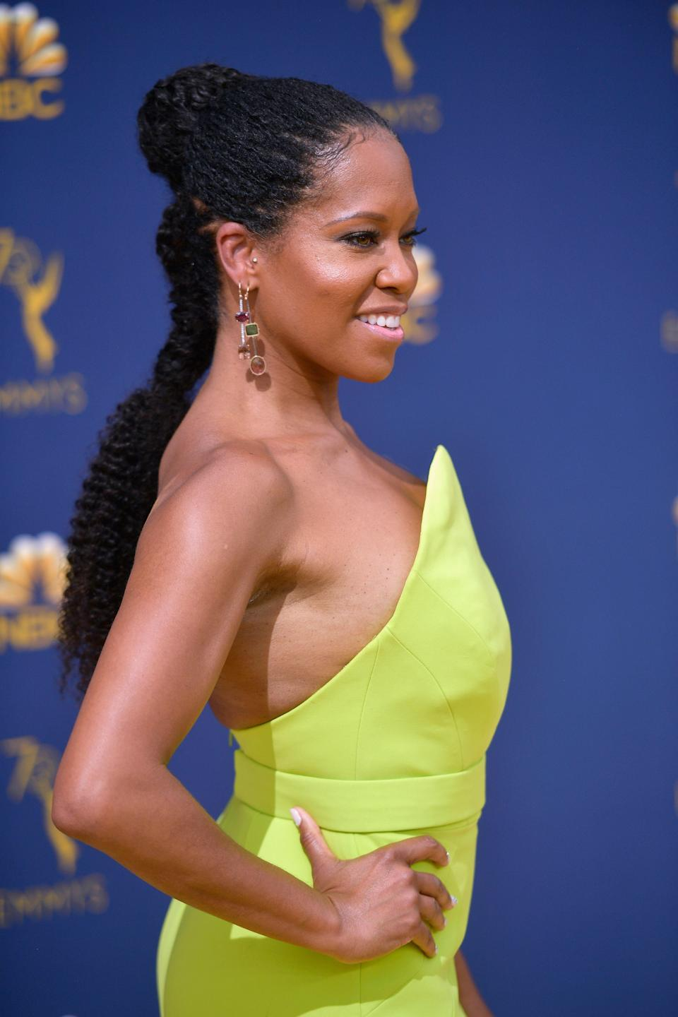 <p>Regina King tied her micro Senegalese twists into a chic two-part updo — giving her sharp neon neckline plenty of room to shine.</p>