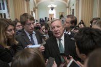 Sen. Dick Durbin, D-Ill., the assistant Democratic leader, is surrounded by reporters asking about the possibility of a partial government shutdown, at the Capitol in Washington, Tuesday, Dec. 18, 2018. Congress and President Donald Trump continue to bicker over his demand that lawmakers fund a wall along the U.S.-Mexico border, pushing the government to the brink of a partial shutdown at midnight Friday. (AP Photo/J. Scott Applewhite)