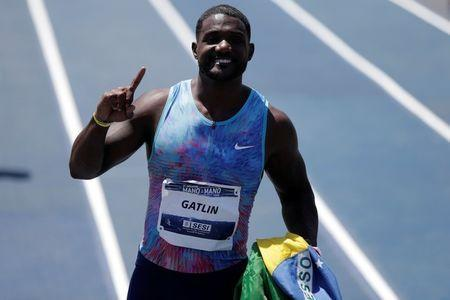 "Justin Gatlin of the U.S. celebrates after winning the ""Mano a Mano"" challenge, a 100-meter race, at the Brazilian Jockey Club in Rio de Janeiro, Brazil October 1, 2017. REUTERS/Bruno Kelly"