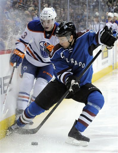 Colorado Avalanche right winger David Jones (54) skates against Edmonton Oilers center Ryan Nugent-Hopkins (93) during the second period of an NHL hockey game on Saturday, March 10, 2012, in Denver. (AP Photo/ Jack Dempsey)