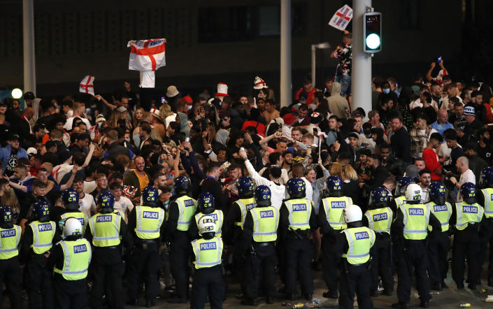 Soccer Football - Euro 2020 - Final - Fans gather for Italy v England - Wembley Stadium, London, Britain - July 11, 2021 Police officers stand guard as England fans gather outside Wembley Stadium during the match Action Images via Reuters/Peter Cziborra
