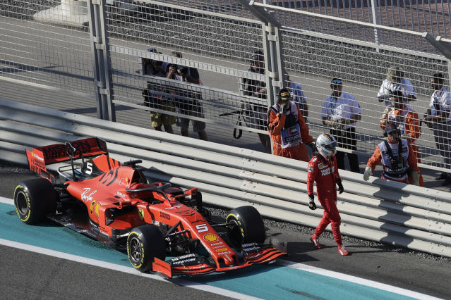 Ferrari driver Sebastian Vettel of Germany walks away from his car after he slipped during the first free practice at the Yas Marina racetrack in Abu Dhabi, United Arab Emirates, Friday, Nov. 29, 2019. The Emirates Formula One Grand Prix will take place on Sunday. (AP Photo/Luca Bruno)