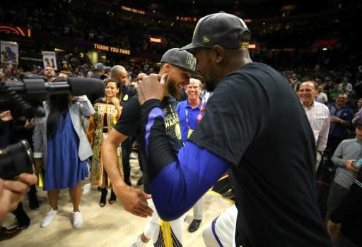 Kevin Durant and Stephen Curry of the Golden State Warriors celebrate after defeating the Cleveland Cavaliers in game four to sweep the 2018 NBA Finals