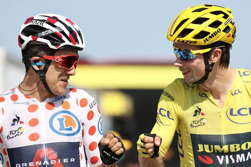 Team Jumbo rider Slovenias Primoz Roglic wearing the overall leaders yellow jersey and Team Ineos rider Ecuadors Richard Carapaz wearing the best climbers polka dot jersey wait prior to the 19th stage of the 107th edition of the Tour de France cycling race 160 km between BourgenBresse and Champagnole on September 18 2020 Photo by KENZO TRIBOUILLARD AFP Photo by KENZO TRIBOUILLARDAFP via Getty Images