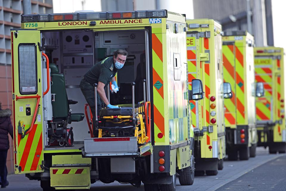 A paramedic wearing a face mask cleans the back of an ambulance at the Royal London Hospital in London, during England's third national lockdown to curb the spread of coronavirus. Picture date: Thursday January 21, 2021. (Photo by Yui Mok/PA Images via Getty Images)