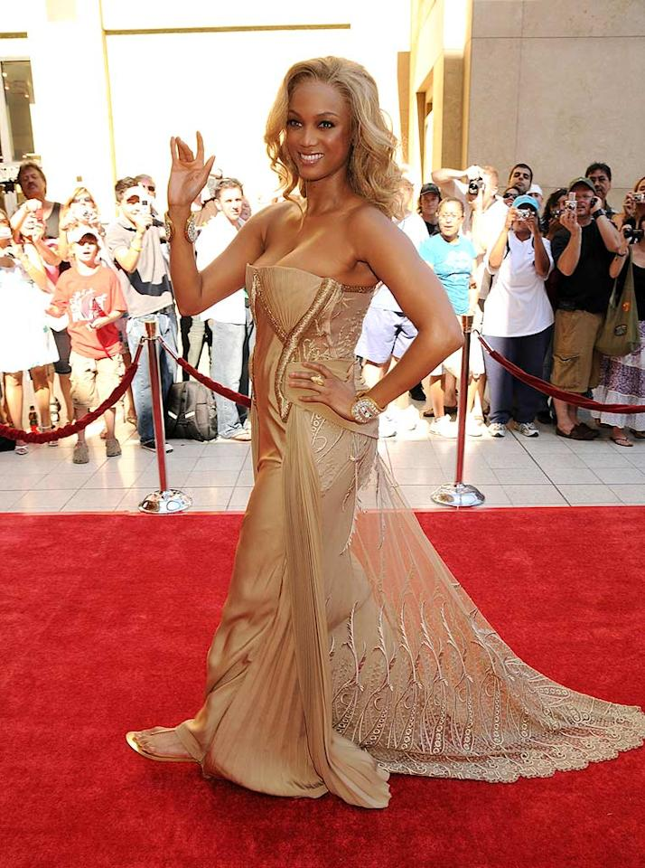 """Tyra may think her new color is gold thanks to the questionable trophy she took home at the Daytime Emmys, but she needs to realize that her matching metallic dress and crispy coif are causing us considerable pain. <a href=""""http://www.wireimage.com"""" target=""""new"""">WireImage.com</a> - September 16, 2008"""