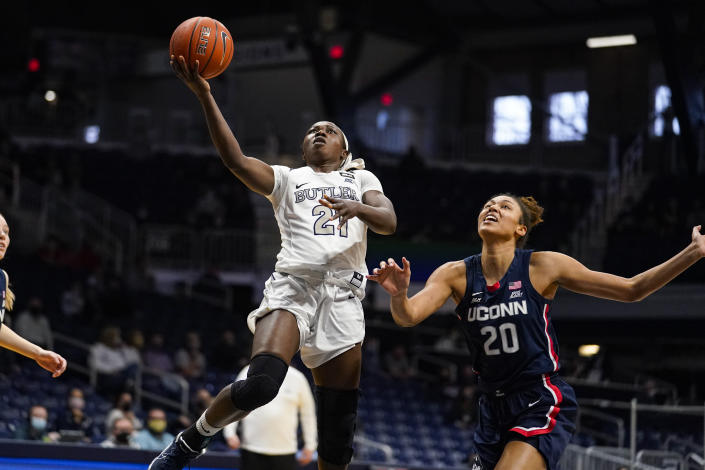 Butler guard Upe Atosu (21) shoots in front of Connecticut forward Olivia Nelson-Ododa (20) during the third quarter of an NCAA college basketball game in Indianapolis, Saturday, Feb. 27, 2021. (AP Photo/Michael Conroy)