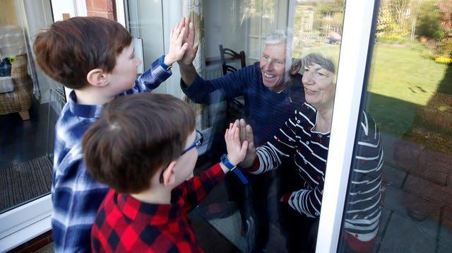 Plans could include grandparents being able to meet their grandchildren outside, reports suggest (Martin Rickett/PA)