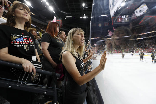 Vegas Golden Knights fans cheer as players warm up for Game 2 of the team's NHL hockey Stanley Cup Finals against the Washington Capitals on Wednesday, May 30, 2018, in Las Vegas. (AP Photo/John Locher)
