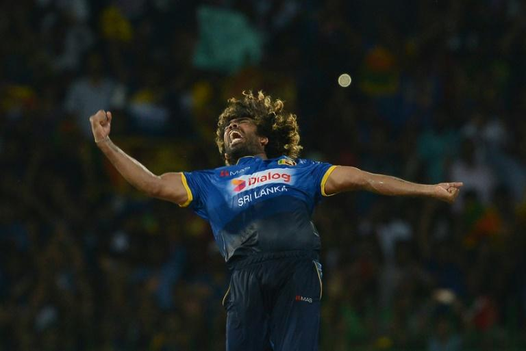 Sri Lankan cricketer Lasith Malinga celebrates taking the hat trick wicket to dismiss Bangladesh cricketer Mehedi Hasan during the second T20 international cricket match between Sri Lanka and Bangladesh in Colombo on April 6, 2017