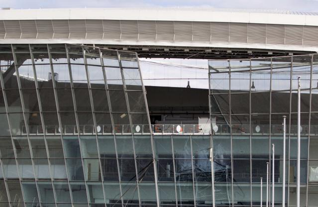 The Donbass Arena stadium, the venue of Euro 2012 soccer matches, is pictured after it was damaged by a blast wave following shelling in Donetsk, eastern Ukraine, October 20, 2014. Security personnel at the stadium said the recent shelling damaged part of the venue. REUTERS/Shamil Zhumatov (UKRAINE - Tags: CIVIL UNREST POLITICS SPORT SOCCER)