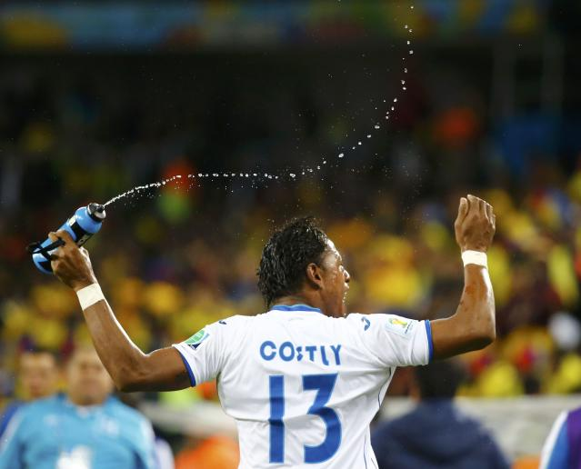 Carlo Costly of Honduras celebrates after scoring a goal during their 2014 World Cup Group E soccer match against Ecuador at the Baixada arena in Curitiba June 20, 2014. REUTERS/Stefano Rellandini (BRAZIL - Tags: SOCCER SPORT WORLD CUP TPX IMAGES OF THE DAY)