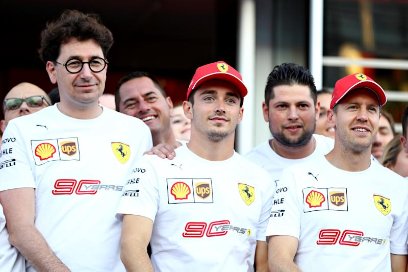 MONZA, ITALY - SEPTEMBER 07: Sebastian Vettel of Germany and Ferrari, Charles Leclerc of Monaco and Ferrari, Ferrari Team Principal Mattia Binotto and the Ferrari team pose for a photo in 90th anniversary t-shirts after qualifying for the F1 Grand Prix of Italy at Autodromo di Monza on September 07, 2019 in Monza, Italy. (Photo by Mark Thompson/Getty Images)