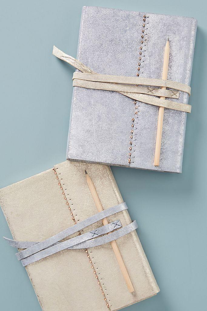 """<p><strong>Anthropologie</strong></p><p>anthropologie.com</p><p><strong>$38.00</strong></p><p><a href=""""https://go.redirectingat.com?id=74968X1596630&url=https%3A%2F%2Fwww.anthropologie.com%2Fshop%2Fkatine-leather-journal&sref=https%3A%2F%2Fwww.thepioneerwoman.com%2Fhome-lifestyle%2Fg34061027%2F50th-birthday-gift-ideas%2F"""" rel=""""nofollow noopener"""" target=""""_blank"""" data-ylk=""""slk:Shop Now"""" class=""""link rapid-noclick-resp"""">Shop Now</a></p><p>A notebook is a thoughtful gift for aspiring writers and everday journalers alike. Suede detailing makes this one extra special. </p>"""
