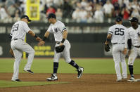 From left, New York Yankees' Gio Urshela, DJ LeMahieu, Gleyber Torres and Didi Gregorius celebrate after defeating the Boston Red Sox in a baseball game, Saturday, June 29, 2019, in London. Major League Baseball made its European debut game Saturday at London Stadium. (AP Photo/Tim Ireland)
