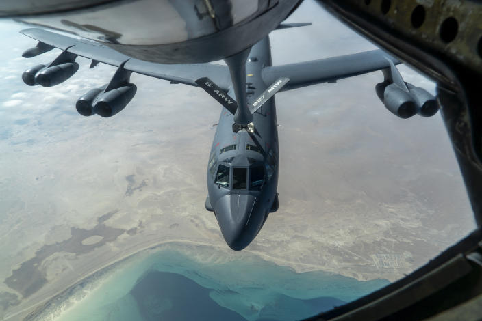 "A U.S. Air Force B-52H ""Stratofortress"" from Minot Air Force Base, N.D., is refueled by a KC-135 ""Stratotanker"" in the U.S. Central Command area of responsibility Wednesday, Dec. 30, 2020. The United States flew strategic bombers over the Persian Gulf on Wednesday for the second time this month, a show of force meant to deter Iran from attacking American or allied targets in the Middle East. (Senior Airman Roslyn Ward/U.S. Air Force via AP)"