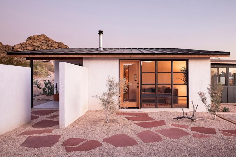 Alison and Jay Carroll transformed a 1950s boarded-up homestead into their own modern oasis.