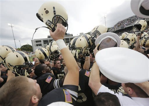 Army players celebrate after their 34-31 win over Boston College in an NCAA college football game Saturday, Oct. 6, 2012, in West Point, N.Y. (AP Photo/Mike Groll)